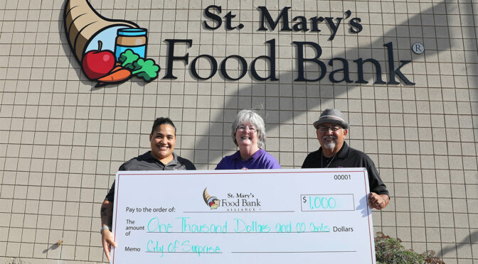 Councilmember Cline presents a check for $1000 to St. Mary's Food Bank.