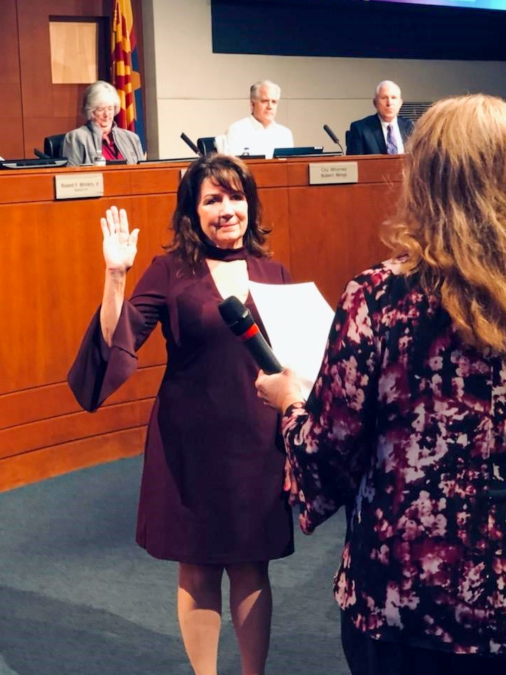 Associate Judge Catherine A. Gaudreau is administered the oath of office by City Clerk Sherry Aguilar.