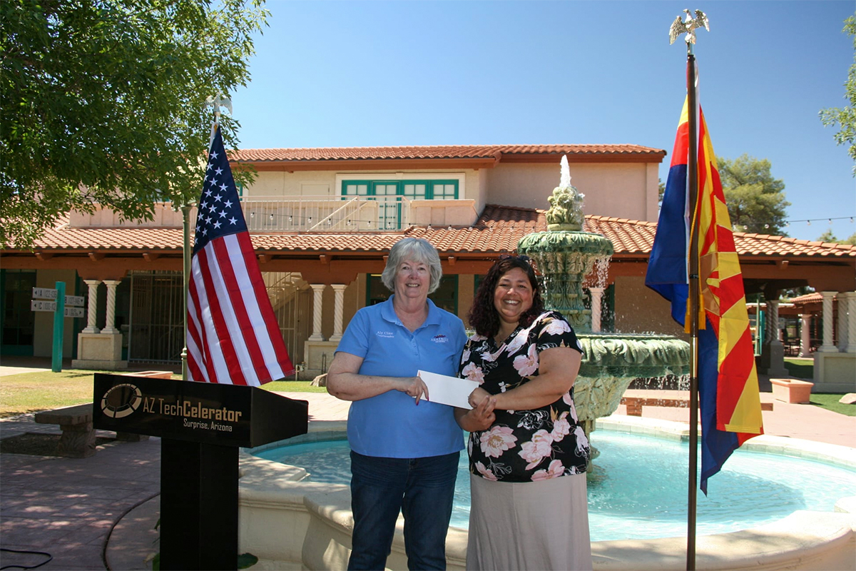 Councilmember Clines gives a donation to the Vetlink Foundation.
